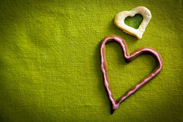 Heart shape candy on green