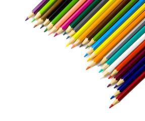 Multi colored pencils in a corner on white background