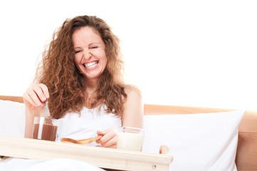 Redhead woman having breakfast milk toast chocolate butter in be