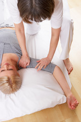 Woman having Shiatsu massage