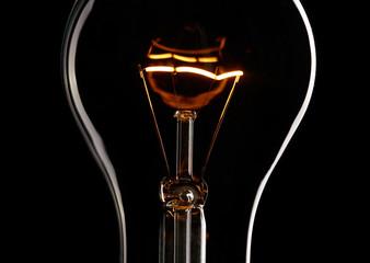 Light bulb over dark background