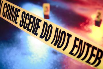 fresh crime scene with yellow tape at night - fototapety na wymiar