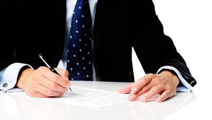 Anonymous man in suit signing a contract