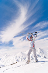 Skier woman on top of mountain