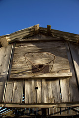 Old Basketball Hoop on Rundown House