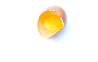 Egg smashed against a white background