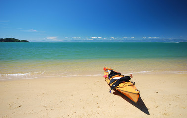 Yellow kayak at a beach. Abel Tasman National Park