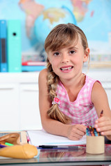 Little girl smiling in classroom