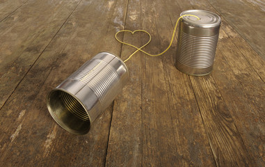 tin can phone with heart shape in wire
