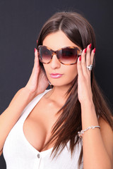 Close up picture of lovely fashion model in sunglasses