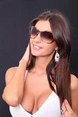 Close up picture of attractive fashion model in sunglasse