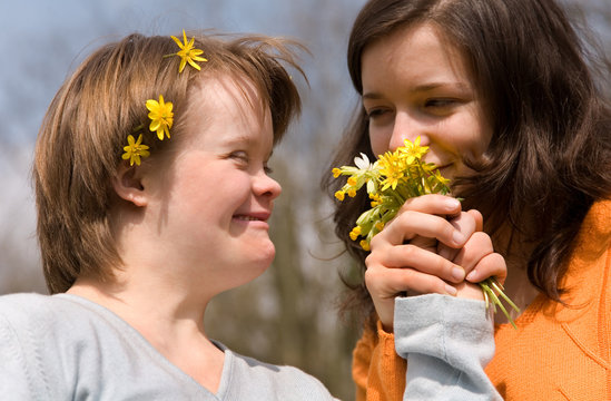 A girl with Down syndrome and her sister.