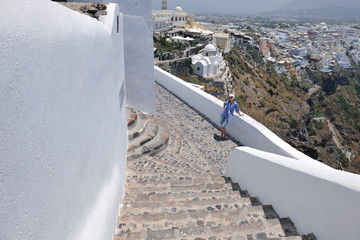 Greek woman on the streets of Oia, Santorini, Greece