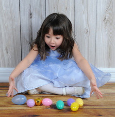 sweet little girl excited over easter eggs
