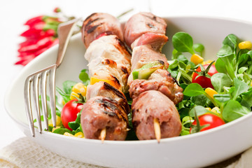 Meat Skewers on white table