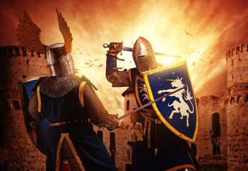 Foto op Canvas Ridders Two knights fighting agaist medieval castle.