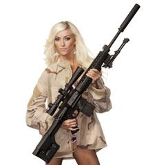 Beautiful young woman with powerful gun rifle
