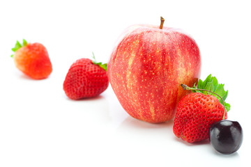 big juicy red ripe strawberries and apple isolated on white