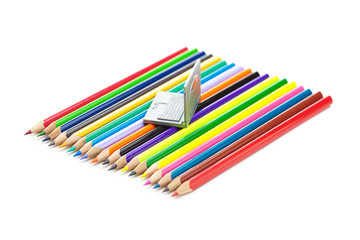colored pencils and miniature laptop isolated on white