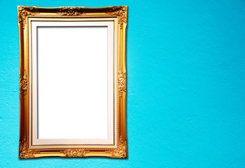 Blank golden frame on blue cement wall