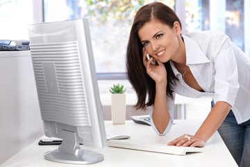 Beautiful woman working in bright office smiling