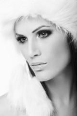 Winter portrait of woman in fur cap
