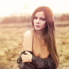 portrait of a beautiful girl in the park in autumn
