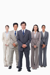 Smiling businessman standing with his team
