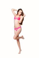 Sexy young woman posing in a bikini. Isolated