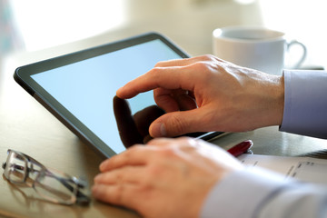 Finge touching screen of a digital tablet