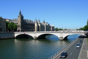Palais de Justice and bridge over Seine river in Paris, France
