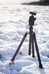 Outdoor photography in winter: tripod sitting in snow