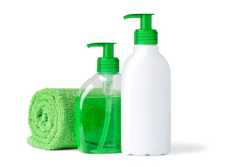 Isolated bathroom objects. Two bottles of liquid soap and towel on white background