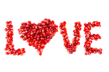 word of love from the seeds of a pomegranate isolated on  white