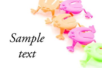 Jumping Toy Frogs with Space for Text