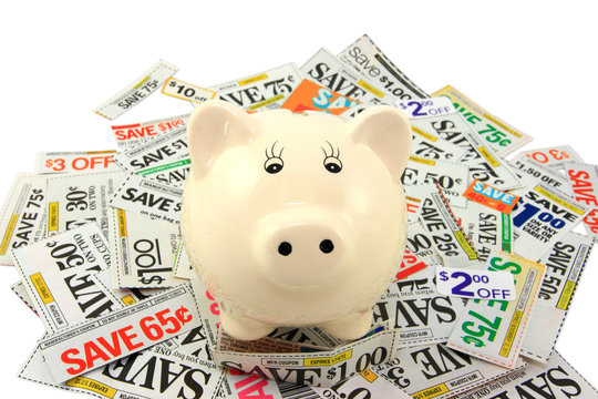 Piggy Bank Standing On Grocery Coupons