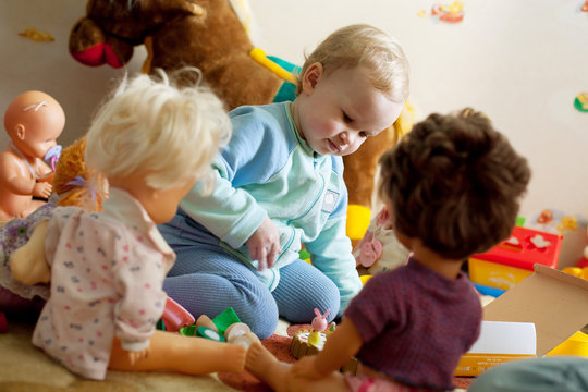 Little girl playing with dolls