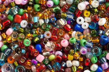 Colorful polished glass beads background, macro