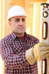 Construction worker using a spirit level