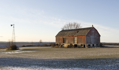 old barn in the evening sun on a winter day