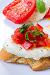 Fresh and tasty bruschetta on white plate