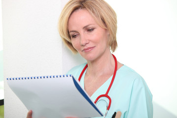 Nurse looking at chart
