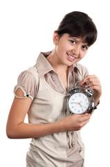 little girl with an alarm clock