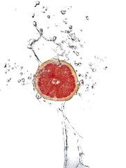 Red grapefruit with splashing water