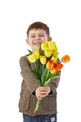 Little boy giving flowers smiling