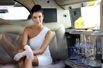 Beautiful woman in limousine