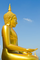Golden buddha statue with blue sky