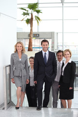 Businesspeople walking through an airport