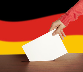 Hand with ballot and box on Flag of Germany