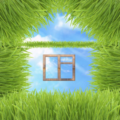conceptual green grass house on sky background
